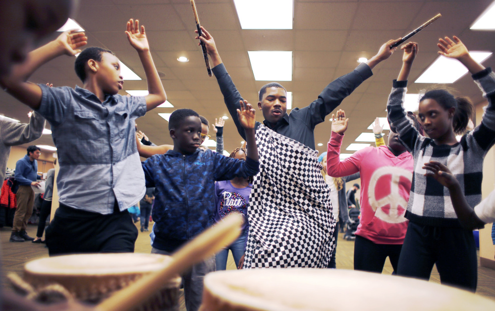 Maurice Habimfura leads children in Rwandan dance lessons Monday during the MLK Day Family Celebration at the Holiday Inn by the Bay in Portland. The event sought to explore Martin Luther King Jr.'s ideals of equality and freedom through the arts, music, poetry and more.