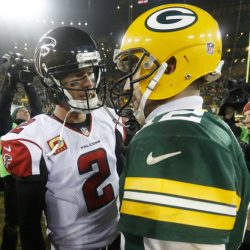 Two of the hottest quarterbacks in the NFL, Matt Ryan of the Falcons, left and Aaron Rodgers of the Packers will meet Sunday in the NFC championship game. Plenty of points are expected.