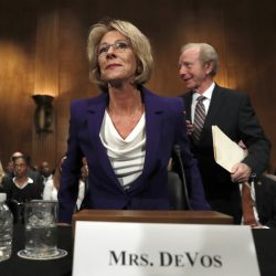 Education Secretary-designate Betsy DeVos arrives on Capitol Hill in Washington on Tuesday. The charter schools advocate hasn't finalized her financial and ethics disclosures.