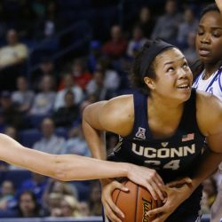 Napheesa Collier of Connecticut protects the ball as Liesl Spoerl, left, and Shug Dickson of Tulsa defend during the second quarter of UConn's 98-58 victory Tuesday night. The Huskies have won 92 consecutive games.