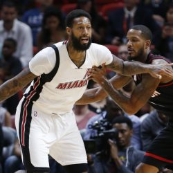James Johnson of the Miami Heat drives past Trevor Ariza of the Houston Rockets during the first half of Miami's 109-103 victory at home Tuesday night.