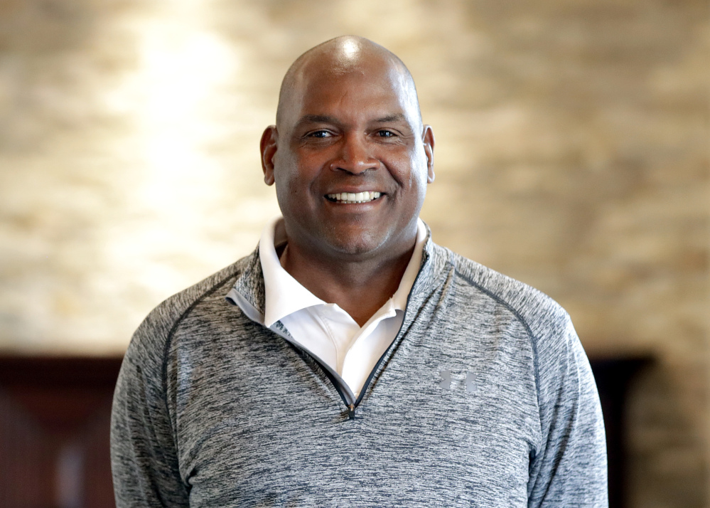 Tim Raines poses for a photograph shortly after being elected to baseball's Hall of Fame on Wednesday. Raines, fifth in career stolen bases, was a seven-time All-Star and the 1986 NL batting champion. He spent 13 of 23 big league seasons with the Montreal Expos and joins Andre Dawson and Gary Carter as the only players to enter the Hall representing the Expos. Raines was elected with 86 percent of the vote. Jeff Bagwell and Ivan Rodriguez were also selected.