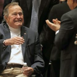 Former President George H.W. Bush, shown acknowledging the crowd at his presidential library in 2014, has used a motorized scooter or a wheelchair in recent years because of vascular parkinsonism, a rare syndrome that mimics Parkinson's disease.