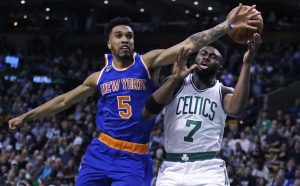 Knicks guard Courtney Lee breaks up a drive to the basket by Boston's Jaylen Brown in the first quarter of Wednesday's game at Boston.