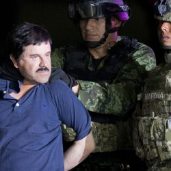 "Joaquin ""El Chapo"" Guzman is escorted to a helicopter by Mexican soldiers and marines at a federal hangar in Mexico City in 2016. Mexico's most notorious cartel kingpin was extradited to the United States on Thursday to face drug trafficking and other charges. Associated Press"