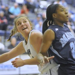 Olivia Healy, left, of the University of New Hampshire battles Tanesha Sutton of Maine during Thursday night's game at Durham, N.H. UNH won, 60-54. (John Ewing/Staff Photographer)