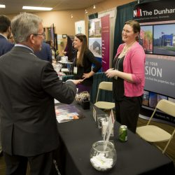 Lindsey Junkins, right, of NAI The Durham Group of Portland, chats with contacts during lunch Thursday at the Maine Real Estate and Development Association annual forecasting conference at the Holiday Inn by the Bay. Brokers and developers are bullish about the Portland marketplace.