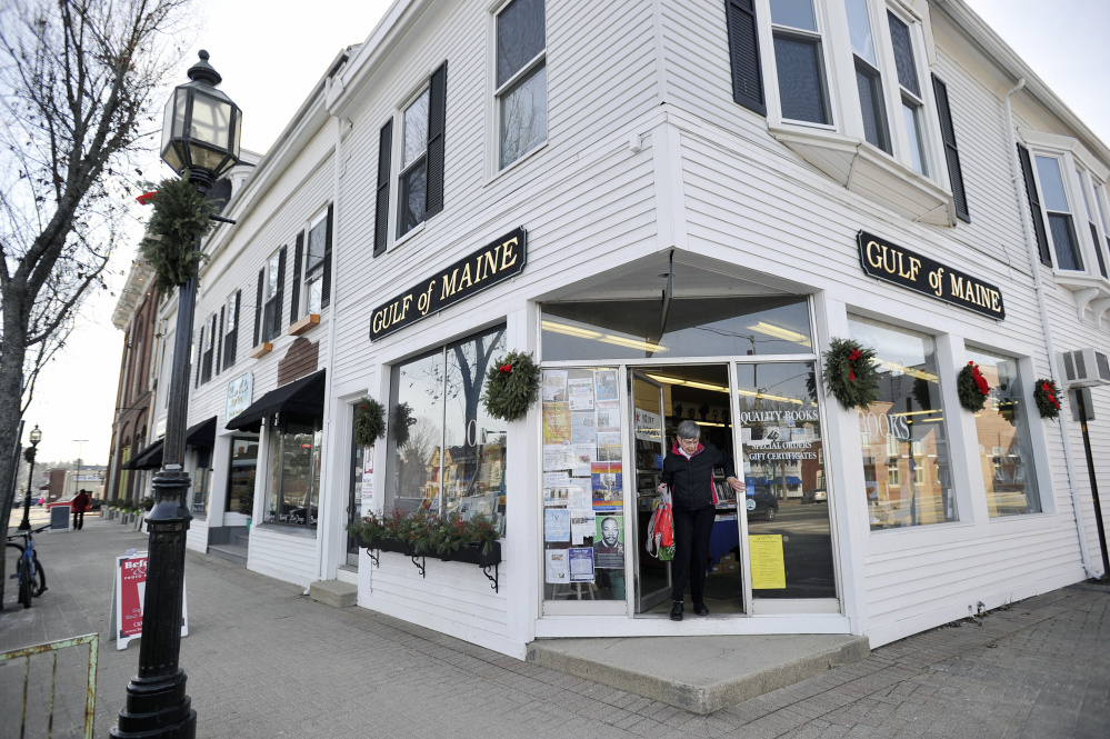 A customer leaves Gulf of Maine Books in Brunswick Tuesday. The shop, described as a utopia of progressive ideas,has helped owner Gary Lawless make a difference in the lives of many Mainers.