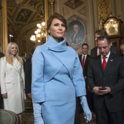 Melania Trump leaves the President's Room of the Senate at the Capitol on Friday after President Trump signed his first legislation. The new White House website lists the brand names of Melania Trump's jewelry lines sold on QVC.