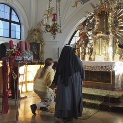 Sister Apollonia, right, and Postulant Claudia Schwarz kneel in the chapel of the abbey in Altomuenster, Germany, on Dec. 6, 2016. The Vatican requested that the abbey be closed.