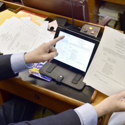 Barry Hobbins, State Rep for district 14 serving Saco, enjoys his iPad getting all the documents and calendars at a moments touch over the seemingly archaic mass of paper prints of those same documents, according to Representative Hobbins. Gordon Chibroski/Staff Photographer