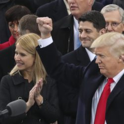 President Donald Trump pumps his fists in the air after his speech during the 58th presidential inauguration at the U.S. Capitol in Washington on Friday.