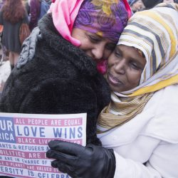 Arbo Sharif, right, of Portland is hugged by a friend as thousands of women, men and children march along Congress Street for the Women's Walk Portland on Saturday.