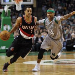 Portland Trail Blazers guard C.J. McCollum drives past Boston Celtics guard Isaiah Thomas during the fourth quarter of Portland's 127-123 overtime win in Boston on Saturday. (Associated Press/Winslow Townson)