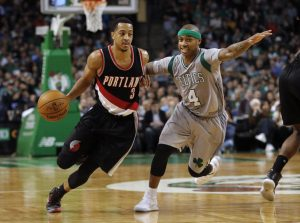 Portland Trail Blazers guard C.J. McCollum drives past Boston Celtics guard Isaiah Thomas during the fourth quarter of Portland's 127-123 overtime win in an NBA basketball game in Boston Saturday, Jan. 21, 2017. (Associated Press/Winslow Townson)