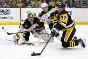 Pittsburgh's Sidney Crosby tries to shoot in front of Bruins defenseman Torey Krug and goalie Tuukka Rask during Sunday's game in Pittsburgh. Crosby had a goal and two assists in a 5-1 win.