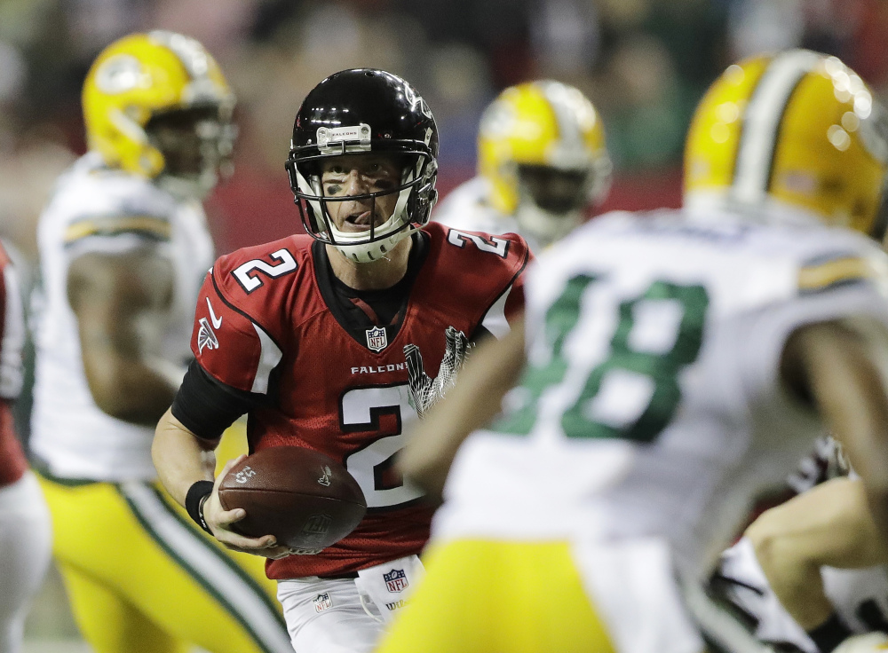 Falcons quarterback Matt Ryan runs for a touchdown during the first half of NFC championship game Sunday against the Green Bay Packers. Atlanta won, 44-21.