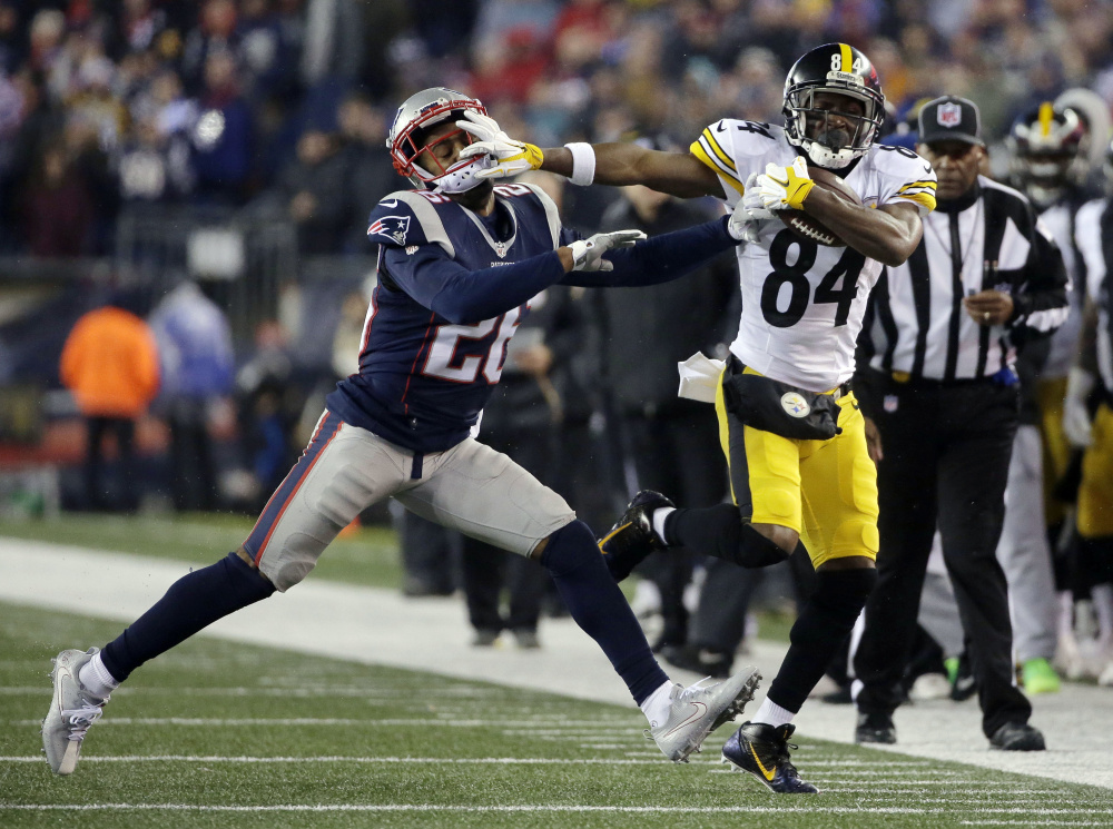 Steelers wide receiver Antonio Brown runs against Patriots cornerback Logan Ryan during the first half
