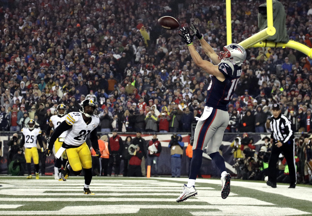 Patriots wide receiver Chris Hogan makes a touchdown reception during the first half.