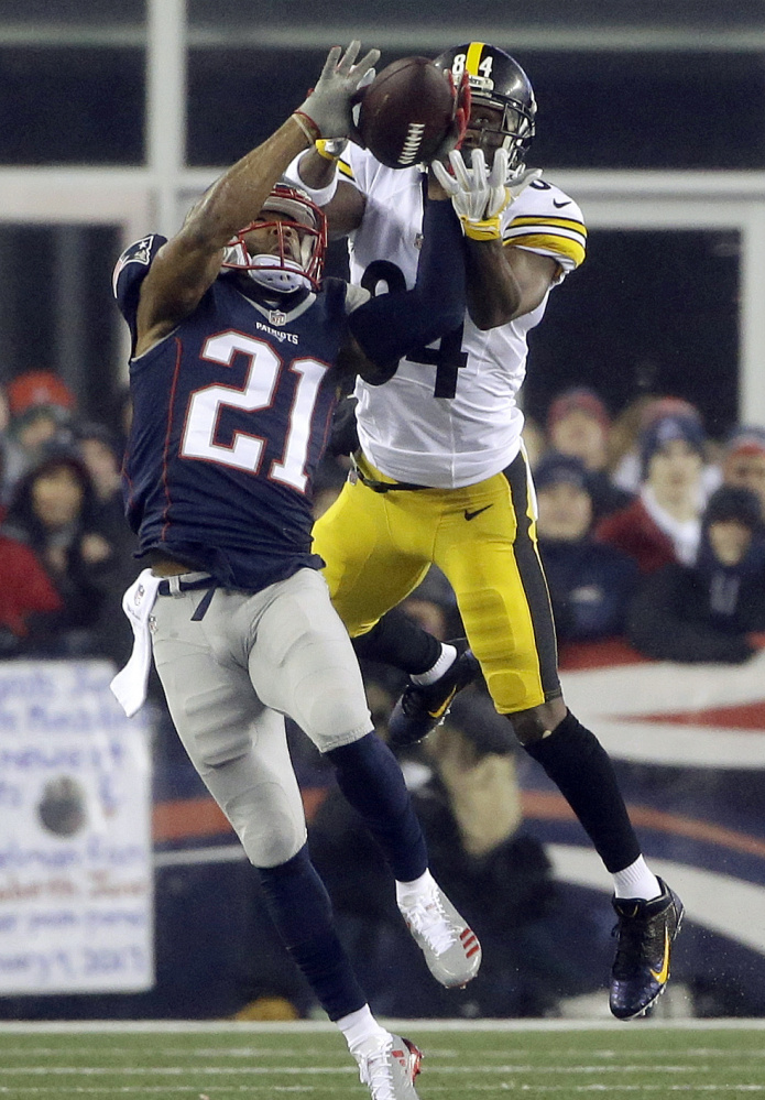 Patriots cornerback Malcolm Butler breaks up a pass intended for Steelers wide receiver Antonio Brown during the first half