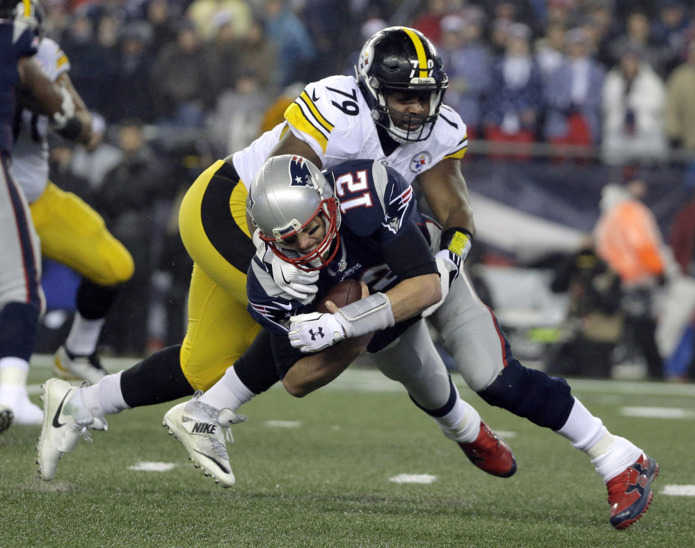 Steelers nose tackle Javon Hargrave sacks Patriots quarterback Tom Brady during the first half