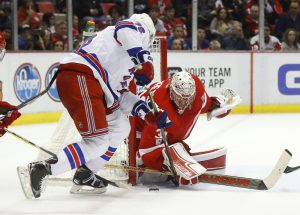 Red Wings goalie Jared Coreau stops a New York Rangers' Brady Skjei shot in the third period Sunday in Detroit.