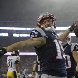 Patriots wide receiver Chris Hogan celebrates his touchdown catch Sunday in the first half against the Pittsburgh Steelers. Hogan had a career game, catching nine passes for 180 yards and two touchdowns. Associated Press/ Elise Amendola