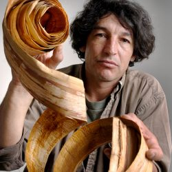 David Moses Bridges, a Passamaquoddy canoe maker, is shown in 2007 holding a piece of bark used in the making of his traditional canoes.