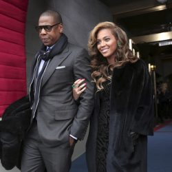 This 2013 photo shows recording artists Jay Z and Beyonce arriving at the Capitol in Washington for President Obama's swearing-in ceremony during the 57th presidential inauguration.
