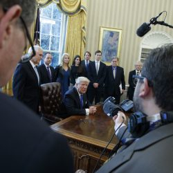 President Trump answers a question after signing a series of executive orders on Tuesday in the Oval Office of the White House in Washington. The administration has instructed officials at the Environmental Protection Agency to freeze its grants and contracts.