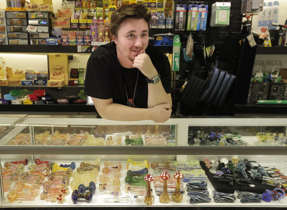 """Sam Putnam, an employee at Awear in Portland, talks about the first day of legal marijuana in Maine. """"It's nice not to have to worry,"""" Putnam said. """"People are more comfortable now than they were before."""""""