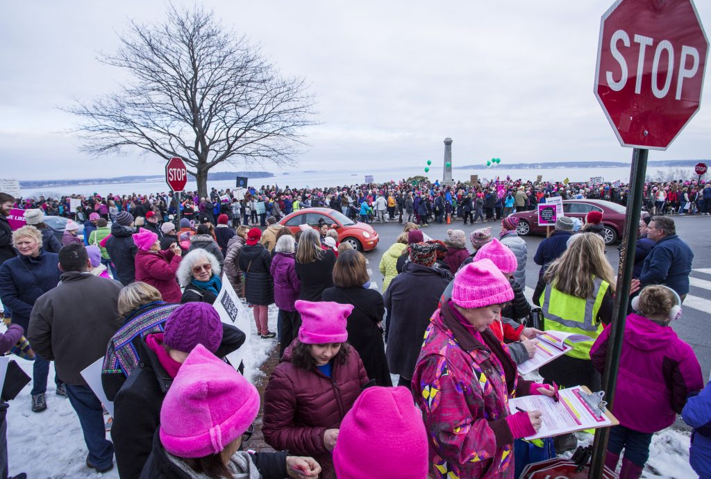 Thousands of people gather to march down Congress Street for the Women's Walk on Saturday.