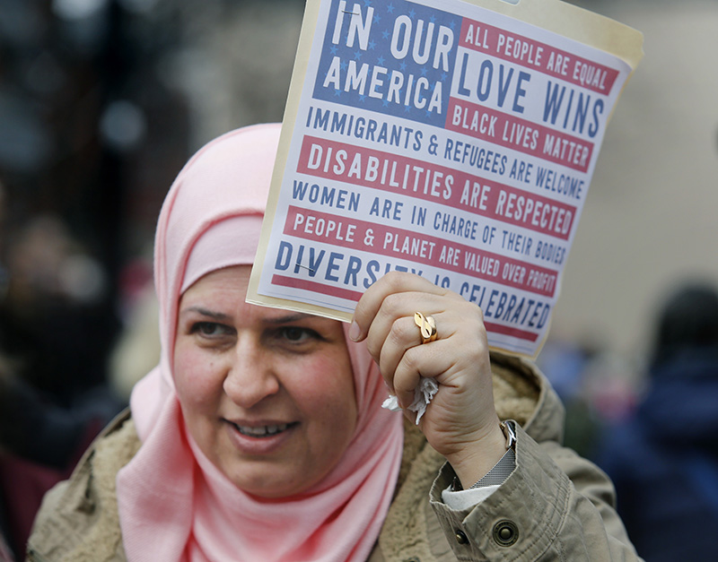 Sanaa Abduljabbar of Portland holds a sign while marching on Saturday.
