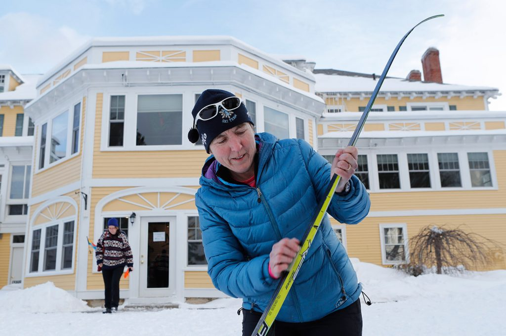 Sarah Southam, a ski coach at Telstar High School, waxes her skis as she prepares to head out on the trails from the Bethel Village Ski Center.