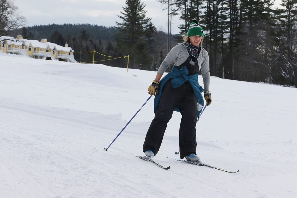 Heather Beveridge of Portland heads down a hill on the groomed trails in Bethel.