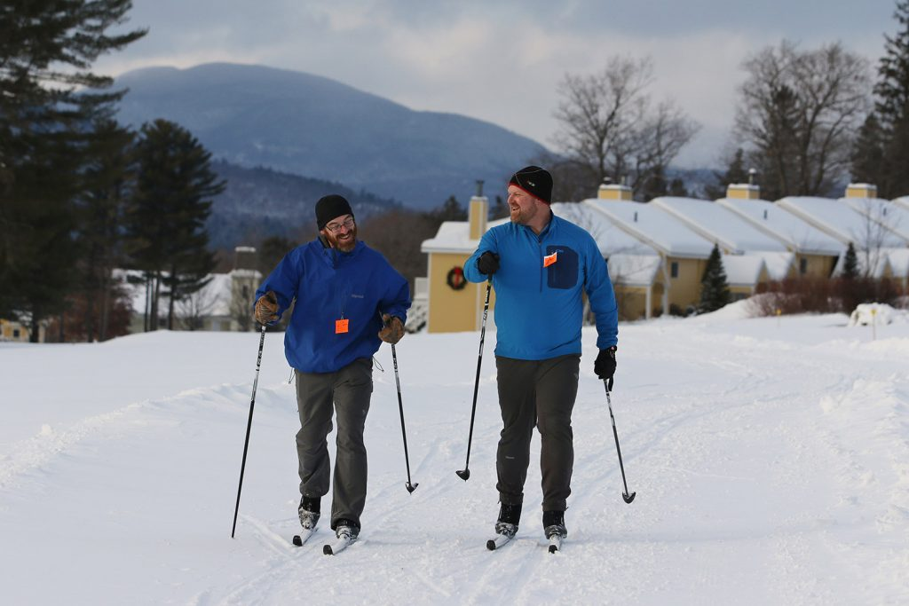 Gabe Perkins, executive director of Mahoosoc Pathways, right, skis with Colin Widdoes, left, at Bethel Village Ski Center. Mahoosoc Pathways partnered with with the Bethel Outing Club and The Bethel Inn Resort to take over running the center this year.
