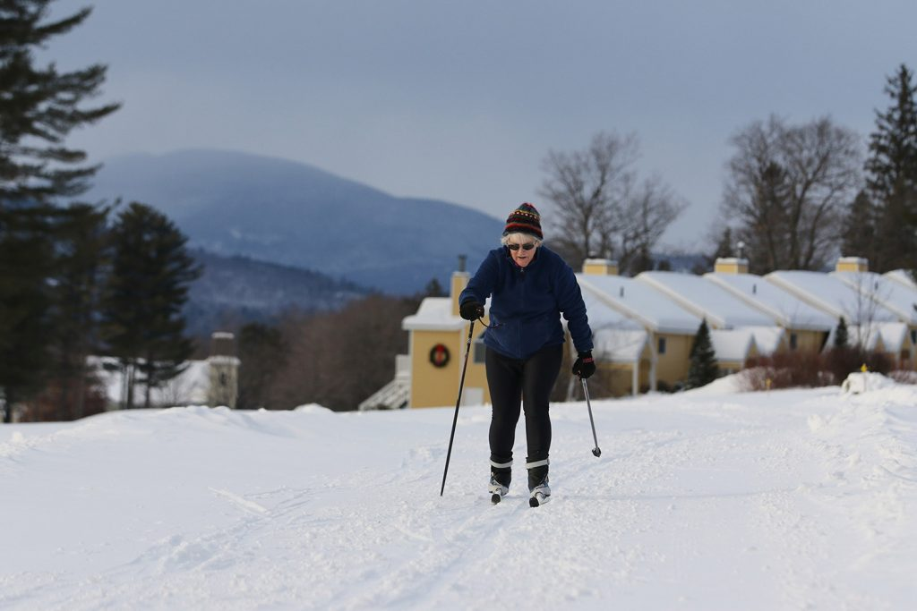 Bonnie Pooley skis away from the Bethel Village Ski Center on freshly groomed snow.