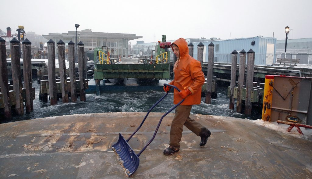 Deckhand Greg Jukins tidies up the car deck of the Machigonne II as it departs the ferry terminal for Peaks Island.