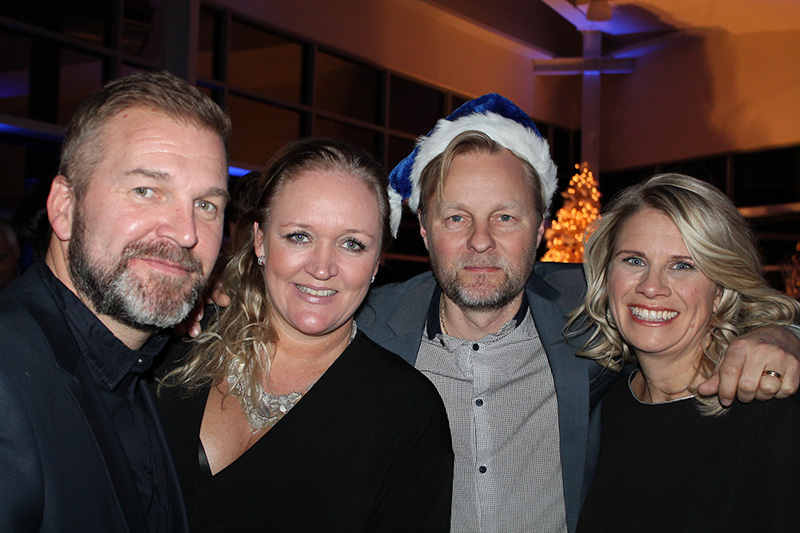Hallgrimur Fridgeirsson and Thorbjorg Arnadottir of Iceland with Larus Isfeld of Eimskip USA, and his wife, Kristin at the holiday party the company gave that benefited Rippleffect.
