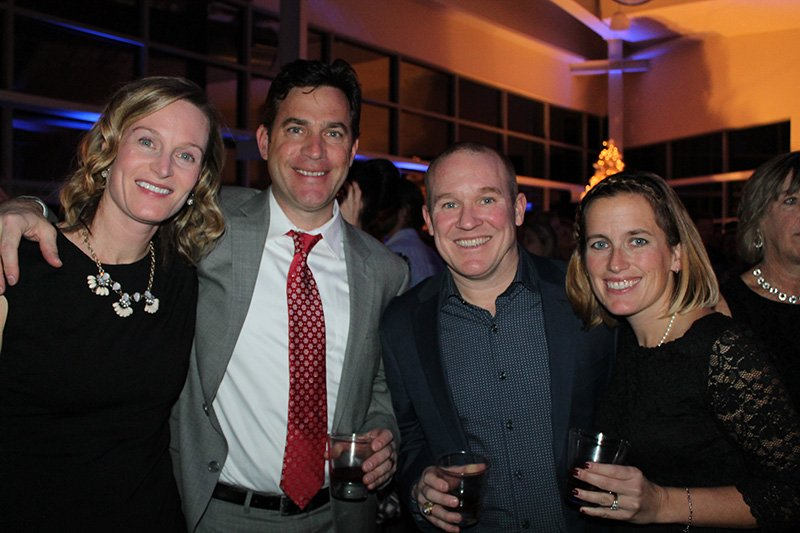 Danyelle and Ryan Tierney celebrate the season with Kevin and Stephanie Ferrie, all of Scarborough at the Eimskip charity party on Dec. 9.