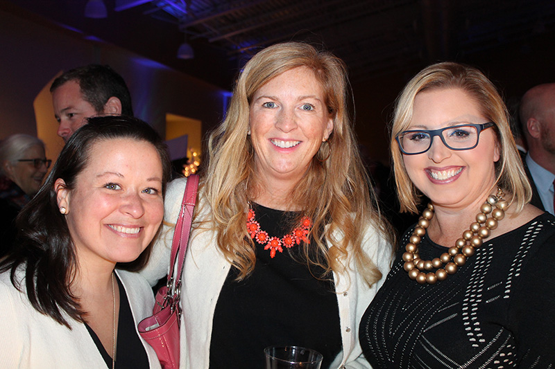Leanne Ouimet, Kristen Levesque and Angie Helton enjoy the festivities at Eimskip's Scandinavian Northern Lights Christmas Charity event at Ocean Gateway in Portland.
