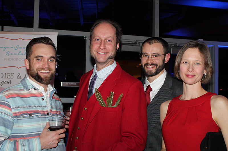 Sean Sullivan, executive director of the Maine Brewers Guild, with David Carlson of Marshall Wharf Brewing Co.; Nolan Stewart, owner of Coastal Root Bitters, and his wife, Molly, director of mission services for Cancer Community Center brought their own greenery to the Eimskip Christmas party.
