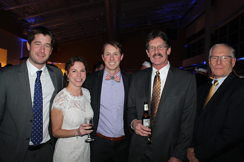 Dane Hutchins of Hutchins Trucking with his sister-in-law, Michelle; brother, Cale; father, Mark, and Bob Tayman, director of operations at the Eimskip Scandinavian Northern Lights party.