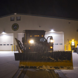 Kennie parks his plow at Buxton's public works facility to wait out the rain before heading out to plow once more.