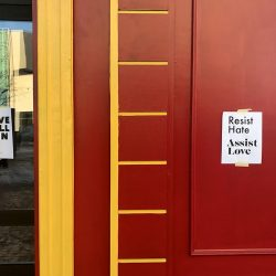 """Signs appeared in storefronts along Congress Street this morning, with messages like """"Resist Hate, Assist Love"""" and """"Love Will Win."""""""