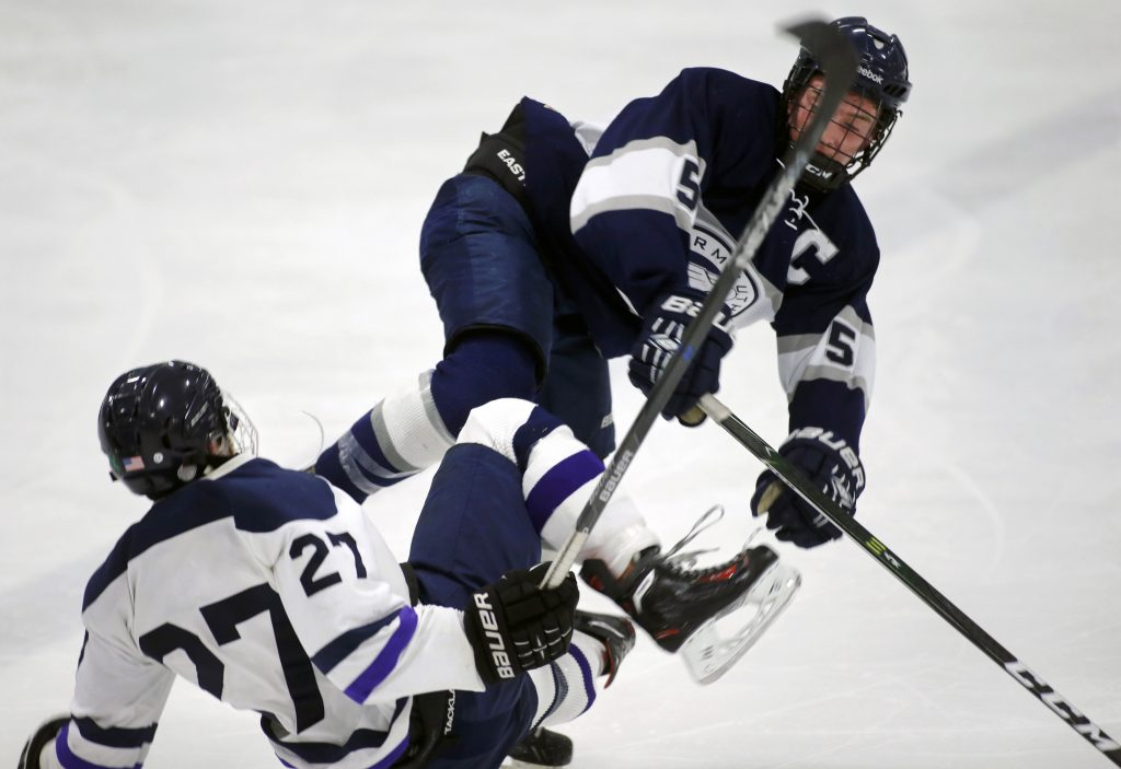 Yarmouth's Chris Romano and Portland/Deering's Donnie Tocci collide at center ice.