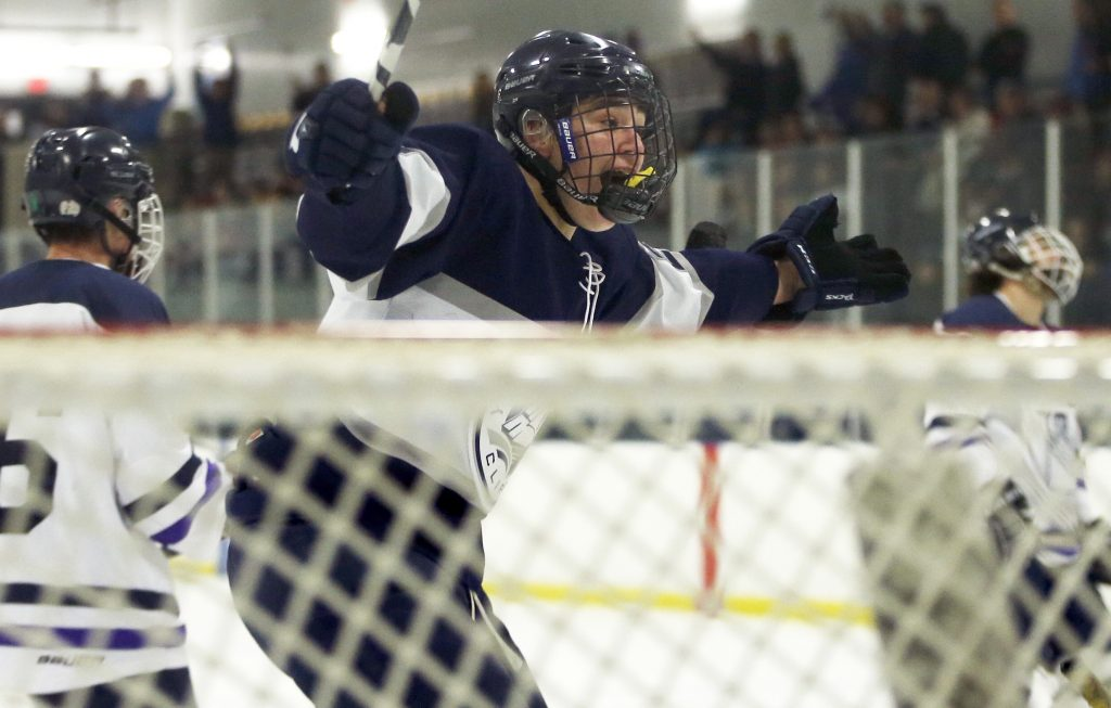 Dom Morrill rejoices after Yarmouth scores its third goal against Portland/Deering in Thursday night's boys' hockey game.