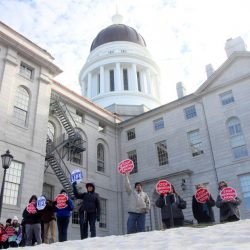 Anti-abortion supporters surround the State House in Augusta on Saturday at the annual Hands Around the Capitol rally to recognize and mourn the 44th anniversary of the Supreme Court's Roe v. Wade decision that legalized abortion. The event is sponsored each year by the Maine Right to Life Committee.