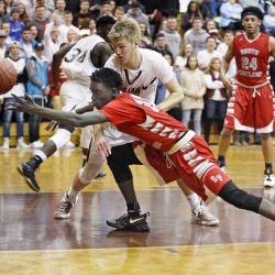 Ruay Bol of South Portland contends for the ball with Austin Boudreau of Thornton Academy in the second half.