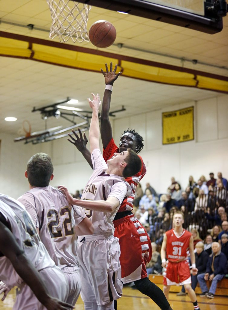 Ruay Bol of South Portland puts up a shot over Avery McKenzie of Thornton Academy in the first half.